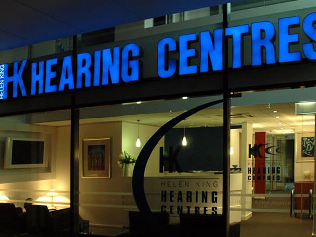 <h1>Helen King Hearing Centre, Kingston</h1>Located on the tranquil Kingston Foreshore, The Helen King Hearing Centre houses what was, previously six separate clinics across Canberra. The design had to be multi-functional to cater for all administration, assembly and adjustments to hearing aids, as well as sound booths for hearing testing. Creative made practical and inventive use of every metre available.  Frosted glazing to office partitions allowed natural light to flow through the centre. All joinery was made in Jarrah or white to bring in warmth whilst maintaining a fresh, crisp interior.